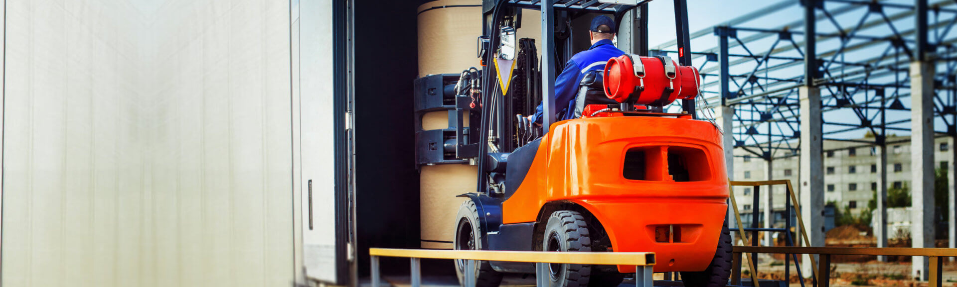 putting cargo from warehouse to truck